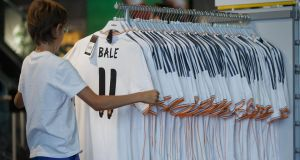 A fan looks at Gareth Bale shirts on sale in the official store at the Estadio Santiago Bernabeu. Photograph: Getty