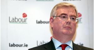 Tánaiste Eamon Gilmore has signalled confidence in Minister of State John Perry so long as his new debt deal with Danske Bank sticks.