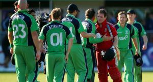 Eoin Morgan of England is congratulated by the Irish team after hitting the winning runs in the RSA Challenge One Day International match between Ireland and England at Malahide yesterday. Photo: Clive Rose/Getty Images