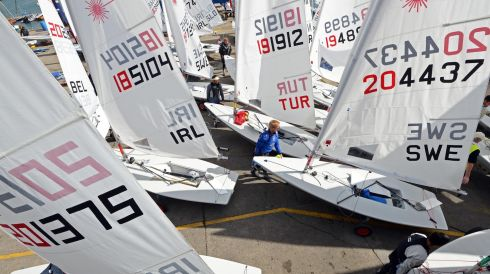 Competitors prepare to launch their boats from the National Yacht Club, at the Laser European and World Sailing Championships, at Dun Laoghaire. Photo: Eric Luke / THE IRISH TIMES