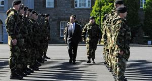 Minister for Justice, Equality and  Defence Alan Shatter performed a ministerial review of troops yesterday in Cathal Brugha barracks. Photograph: Dave Meehan