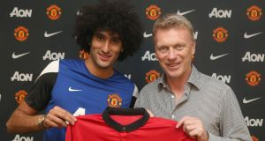 Marouane Fellaini and David Moyes after the Belgian's move from Everton to Manchester United. Photograph: Getty Images