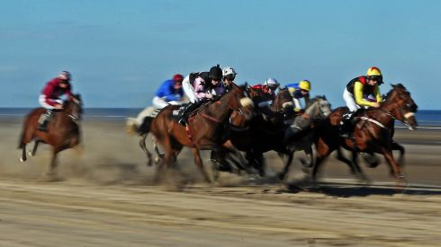 A view of the field in the fourth race of the day at Laytown races Co.Meath. Photo : INPHO/Donall Farmer