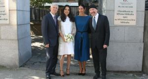 Adam Clayton and his new wife Mariana Teixera pose with The Edge and his wife Morleigh outside the registry office in Dublin in which they got married today. Photograph: Mark Doyle