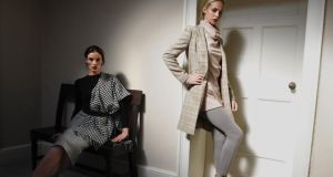 Models wearing a Glencheck skirt with wool jersey top (left) and a coachman jacket in Magee tweed over a pink cowel-neck sweater at the Helen McAlinden fashion show yesterday. Photograph: Aidan Crawley
