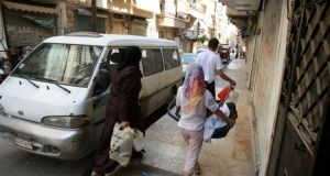 Members of a  family carry their belongings as they move into the Salah al-Din neighbourhood in central Aleppo. Photograph: Reuters/Ammar Abdullah