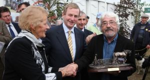 Seán McConnell receiving a lifetime achievement award from Taoiseach Enda Kenny and National Ploughing Association managing director Anna May McHugh at the National Ploughing Championships in 2011. Photograph: Jack Caffrey