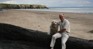 Kevin Haugh with Buddy in west Clare: During chemotherapy, Haugh felt like he had a permanent hangover. Photograph: Mary Haugh