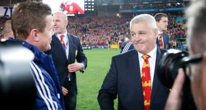 British and Irish Lion's head coach Warren Gatland  shakes hands with  Brian O'Driscoll after winning the third Test against Australia in Sydney. Photograph:   David Gray/Reuters