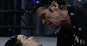 Willem Dafoe and Ellen Page acting out a scene for the game using motion-capture technology