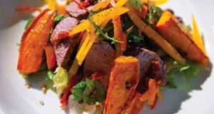 Roast spiced sweet potato and lamb salad with a lemon and mixed seed dressing