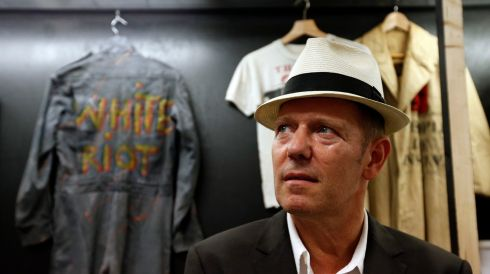 Paul Simonon with a boiler suit which he wore when photographed for the cover of The Clash's first, eponymously titled, album. People will kill for lesser items. He's at the Black Market Clash pop-up exhibition and store in Soho, London, to mark the release of the group's remastered collected works Sound System box set and new best of collection, Hits Back. Photograph: Jonathan Brady/PA Wire