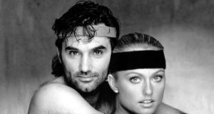"George Best with Swedish former Miss World Mary Stavin, publicising their fitness routine for lovers, ""It Takes Two To Shape Up And Dance."""