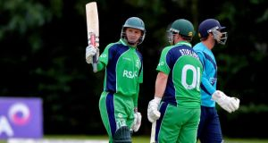 Ireland skipper William Porterfield celebrates his half-century during the World Cup qualifier against Scotland at Stormont. Photograph:   Rowland White/Inpho/Presseye