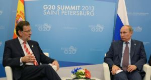 Spanish prime minister Mariano Rajoy (left) meets Russian president  Vladimir Putin during the G20 summit in St Petersburg yesterday. Leaders of the G20 nations made progress on tightening up on multinational company tax avoidance. Photograph: Iliya Pitalev/Host Photo Agency via Getty Images
