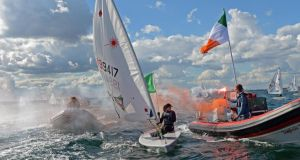 Ireland's Annalise Murphy is escorted by a flotilla of supporters on winning the Laser European Championships at Dun Laoghaire. Photograph: Eric Luke.