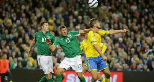 Republic of Ireland's Robbie Keane and Jon Walters with Per Nilsson of Sweden. Photograph: Inpho