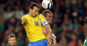 Sweden's Zlatan Ibrahimovic with Richard Dunne of Ireland. Photograph: Inpho