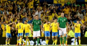 Ireland's Glenn Whelan and John O'Shea dejected after Sweden's second goal. Photograph: James Crombie/Inpho