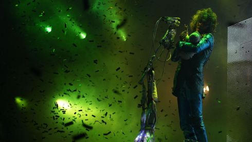 Wayne Coyne of The Flaming Lips mid-performance on the Main Stage at Bestival. Photograph: Yui Mok/PA Wire