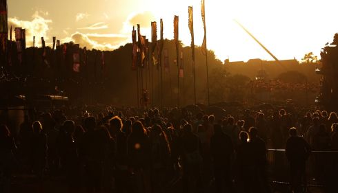 The sun sets on Bestival goers. Photograph: Yui Mok/PA Wire