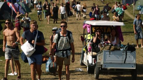 Golf carts at a festival...tis far from that we were raised. Photograph: Yui Mok/PA Wire