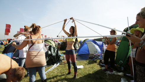 How many festival-goers do you need to erect a tent? Photograph: Yui Mok/PA Wire