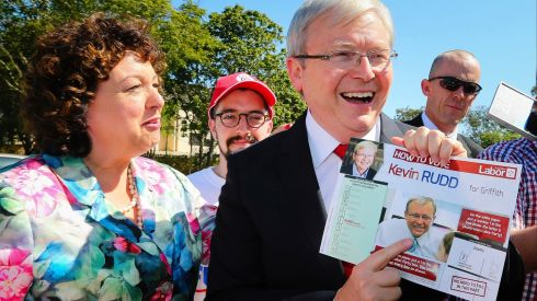 Kevin Rudd, Australia's outgoing prime minister and leader of the Labor Party, points to a photograph of himself printed on a how-to-vote card as he and his wife Therese Rein arrive at the polling station at St Paul's Anglican Church in Brisbane, Australia. Australians have ejected the Labor Party after six years in power, and voted opposition Leader Tony Abbott's Liberal-National coalition into power. Photograph: Patrick Hamilton/Bloomberg