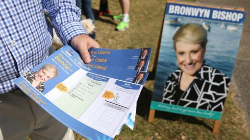 A volunteer for the Liberal Party hands out how-to-vote cards for party member Bronwyn Bishop outside the polling station at The Forest High School in Sydney, Australia. Photograph: Brendon Thorne/Bloomberg