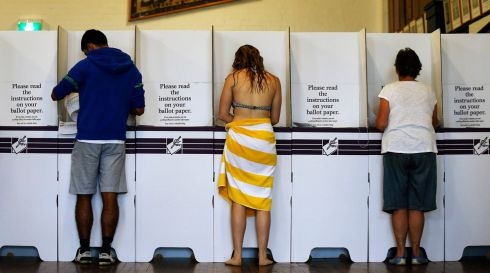 The beach is calling: Marking ballots at Bondi on polling day. Photograph: Daniel Munoz/Reuters