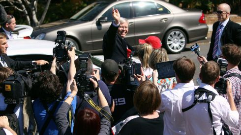 Prime minister Kevin Rudd amid a media throng waving to supporters after casting his vote at a polling station in Brisbane. Photograph: Peter Barnes/Reuters