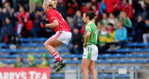 Cork's Angela Walsh celebrates her side's  second goal during the TG4 All-Ireland Senior Championship semi-final against Kerry at  Semple Stadium in  Thurles. Photograph: Ryan Byrne/Inpho