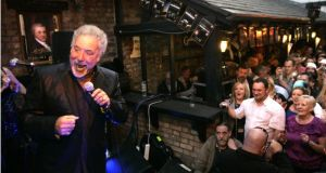 """While you can't blame Guinness for people being so stupid that they'll get drunk in celebration of a genius marketing campaign, you can blame Guinness for facilitating it."" Tom Jones performs at the Brazen Head pub in Dublin as part of the 2009 Arthur's Day celebrations. Photograph: Dara Mac Dónaill"