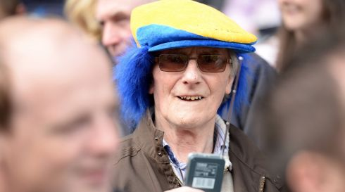A Clare fan listening to the final  yesterday at Croke Park. Photo: Cyril Byrne   / THE  IRISH TIMES