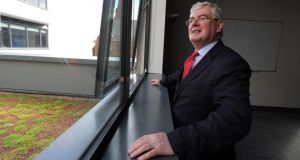 Tánaiste Eamon Gilmore at the Skainos centre in Belfast last month.  Photograph: Paul Faith/PA Wire