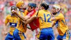Clare's Patrick Donnellan, Cian Dillon, Colin Ryan and Conor McGrath surround Christopher Joyce of Cork during the All-Ireland hurling final at Croke Park.   Photograph: James Crombie/Inpho