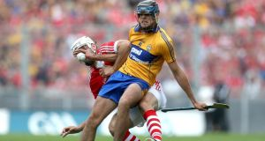Cork's Patrick Cronin is challenged by   Brendan Bulger of Clare. Photograph:   Ryan Byrne/Inpho