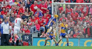 Clare goal keeper Patrick Kelly saves a free from Cork's Anthony Nash. Photograph: Inpho