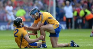 Brendan Bugler (right) congratulates Domhnall O'Donovan of  Clare on scoring the last point to draw the game with Cork  at Croke Park. Photographer: Dara Mac Dónaill
