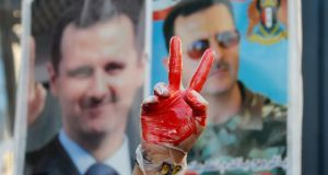 A supporter of Syria's President Bashar al-Assad gestures  near the US embassy in Lebanon. REUTERS/Mohamed Azakir