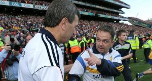 Cork manager Jimmy Barry-Murphy (left) and Clare counterpart Davy Fitzgerald might have been briefly discussing the replay to come as they shake hands after Sunday'as drawn All-Ireland SHC final at Croke Park. Photograph:   Morgan Treacy/Inpho
