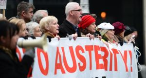People marching along Dublin's O'Connell street during an Anti-Austerity march in November 2012.Photograph: Alan Betson / THE IRISH TIMES