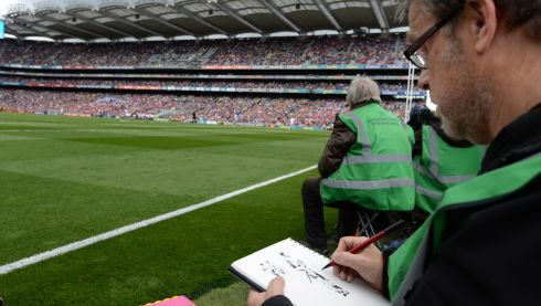 Artist Roger O'Reilly, working at the ll-Ireland hurling finals at Croke Park. Photographer: Dara Mac Donaill/The Irish Times