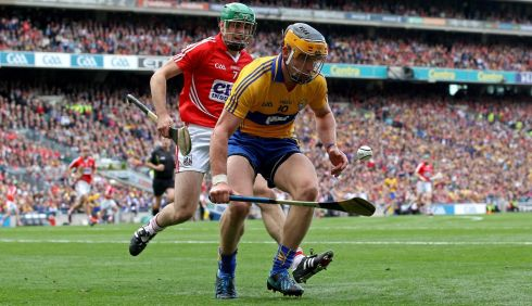 Cork's William Egan and John Conlon of Clare. Photograph: Ryan Byrne/INPHO