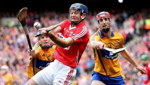 Clare's Padraic Collins and Darach Honan with Christopher Joyce of Cork. Photograph: James Crombie/INPHO