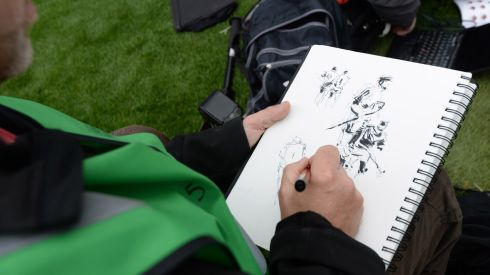 Artist Roger O'Reilly, working at the  All-Ireland hurling finals at Croke Park. Photographer: Dara Mac Donaill/The Irish Times