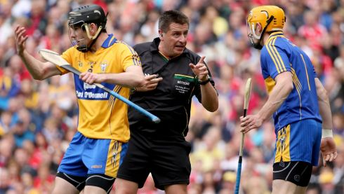 Referee referee Brian Gavin warns goalkeeper Patrick Kelly of Clare. Photograph: James Crombie/INPHO