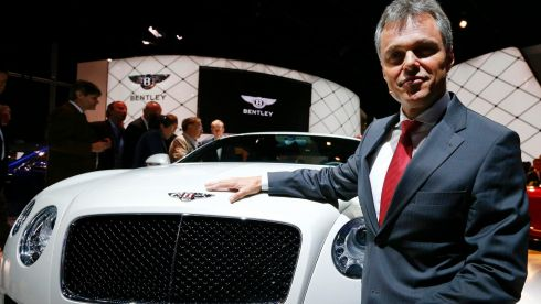 Wolfgang Schreiber, chairman and chief executive of Bentley Motors poses with the new Bentley GTV8S. Photograph: Ralph Orlowski/Reuters