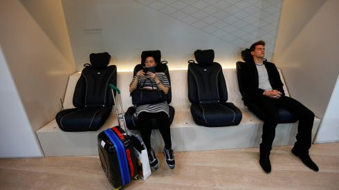 Visitors relax in Mercedes Benz S class massage seats during a media preview day at the Frankfurt Motor Show (IAA).  Photograph: Kai Pfaffenbach/Reuters