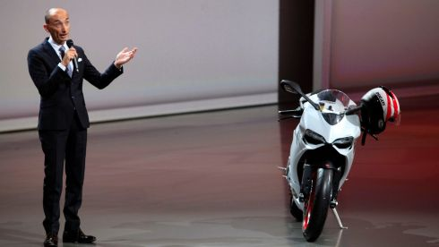 Claudio Domenicali, chief executive officer of Ducati Motor Holding SpA, a unit of Audi AG, gestures as he stands near one of the company's luxury motorbikes during a news conference at the 65th Frankfurt International Motor Show. Photograph:  Krisztian Bocsi/Bloomberg